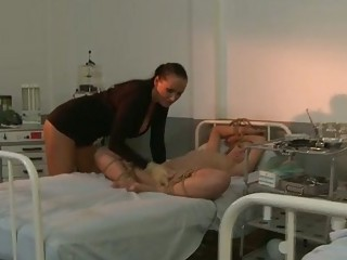 Two dominas punishing two girls in hospital