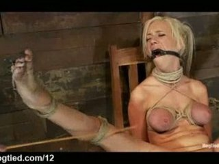 Busty bound blonde caned and vibed in chair