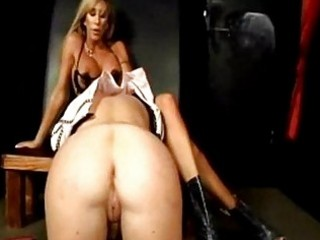 Blonde slave getting her pussy whipped mistress riding on he