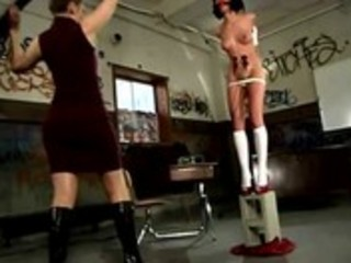 Merciless femdom teacher flogging girl