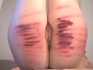 Bondage girl gets spanking to blood