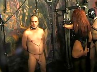 chains, slaves and whips in pleasure dungeon