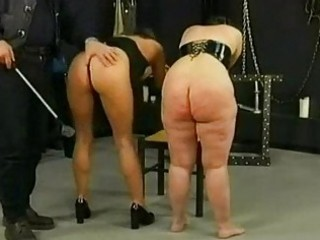 Two german slaves gets spanked on their butts by master in a