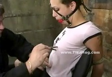 Ball mouth gag holds whore silent