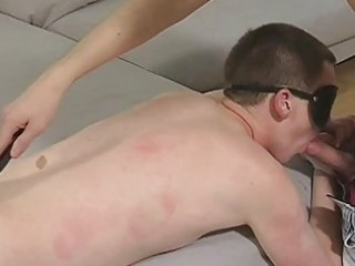 Blindfolded twink gets spanked and sucks cock