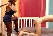 Classy bitch in black pantyhose whips her male slave
