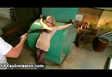 chained busty blonde flogged and nipples clamped in basement