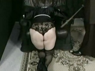 Horny nun is kneeling and bend over a chair and is spanked o
