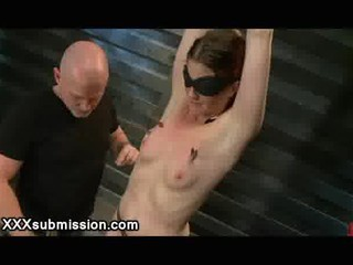 Bound blindfolded babe gets spanked and clamped