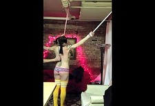 flogged, spanked, and belt-whipped, while tied to pipes in the ceiling.