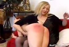redhead gets a over the knee spanking in her tight jeans