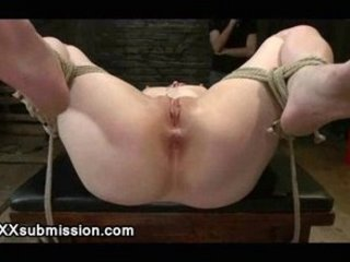 Bound spread babe on a table flogged and caned
