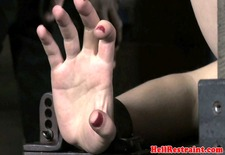Hog tied submissive caned by black dom