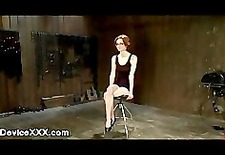 bound to a wooden wall babe gets flogged and rides sybian