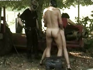 Blind folded slave tied to a wall gets her titties spanked a