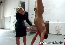 Mistress hangs slave by ankles for punishment