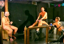 poor male slaves are caned and waxed one at a time