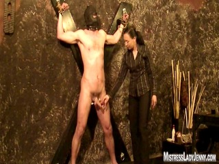 lady jenny tortures bondman bound to the wall