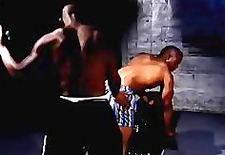 black dude spanked in blue boxers