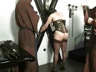 Hot naked slave with pierced pussy is tied and spanked on he