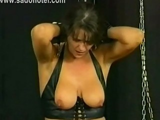 Beautiful milf slave is spanked and got large metal clamps w