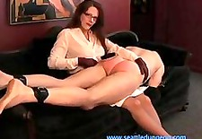 Domme Spanks Slave Over Knees Two