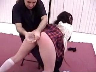 Cute brunette schoolgirl gets her ass toyed and spanked for punishment