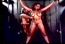 large titted harem serf gets an way-out whipping (in slow motion)