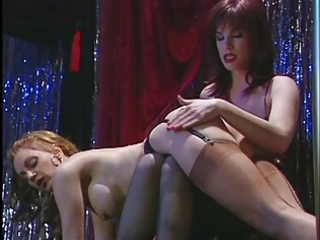 Brunette whore spanks the blond babe&s ass