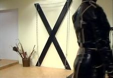 Military caning by latex mistress