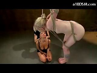 Bondage Girl Standing On Bar Tortured With Shocked Spanked Pussy Stimulated With Vibrator By Other Girl And Mistress In The Dungeon