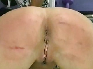 Horny beautiful brunette slave with big boobs is spanked on