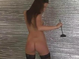 Tight ass brunette in black stockings poses with horse whip