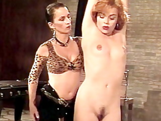slave woman is educated in nude by her master woman