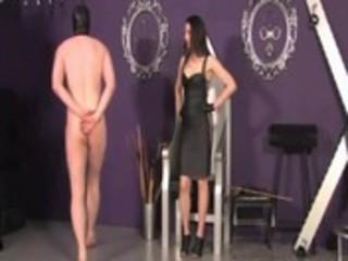 Mistress spanks her pathetic subject for punishment