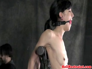 vertical frogtied sub spanked with cane
