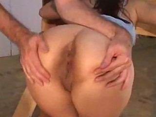 Girl tied in stocks sucking dildo whipped by master in the d