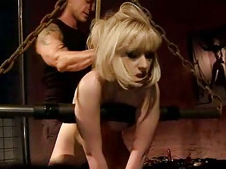 Blonde being painfully punished