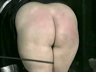 Bend over nun is spanked on her ass and hands with a wooden