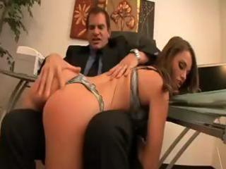 Brunette secretary gets spanked by boss and blows him before getting nailed