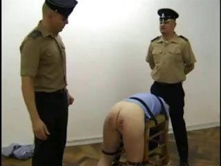 Naughty blonde prisoner gets cuffed to a stool and whipped hard by the guards