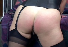 sexy brunette whips and spanks redhead bent over table