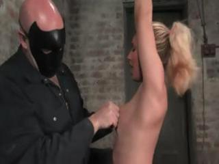 Blonde gets strung up and suspended and gets toyed and spanked