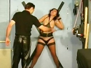Girl getting tied to cross spanked with stick nipples vacume