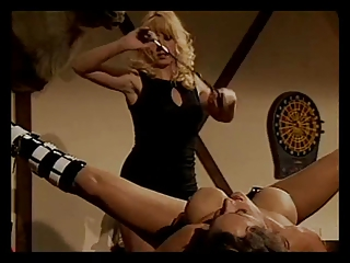 Babe gets nipple clamps and pussy spanking