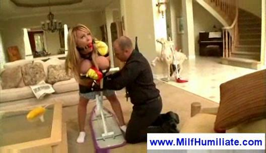 Tied up milf gets spanked
