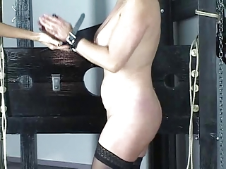 Cute brunette in corset is restrained by master before hard spanking play