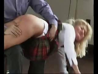 Sexy schoolgirl without knickers gets her ass spanked and caned