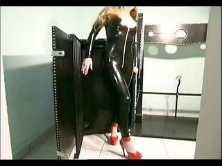 blonde slave girl looking hot in latex