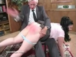 Brunette taking a hand spanking as a punishment